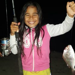 Anahera with her first fish caught at Whangarei Heads